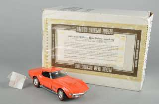 MINT Orange 1969 Chevy Corvette Stingray 124 Diecast Model Car w/ Box